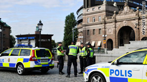 Police stand outside Sweden's parliament building in Stockholm on October 1, 2010.