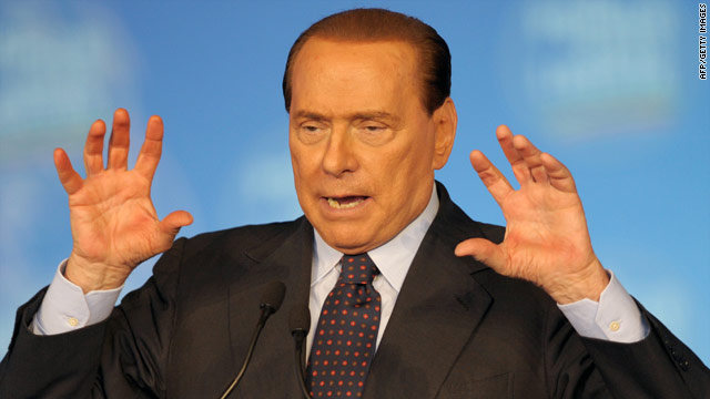 Silvio Berlusconi gestures as he delivers a speech in Milan on Monday.