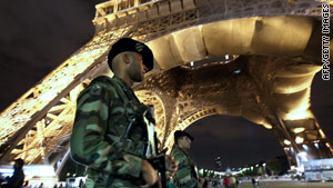 French Army soldiers patrol near the Eiffel Tower in Paris as Europe remained on alert for a possible al Qaeda attack.