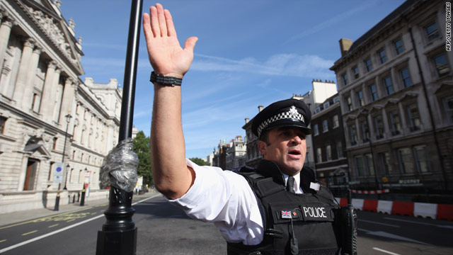 A policeman keeps the public back last week after a suspect vehicle is checked in central London.