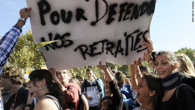 French students hold a banner reading in French 'to defend our pensions' during a protest on October 7 in Marseille.
