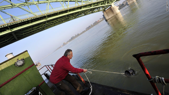 A Hungarian scientist tests samples in the Danube on Friday -- readings indicate the pH level is 8.5, only slightly above normal.