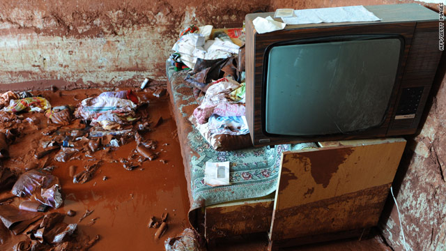 A television is seen in a house damaged by a wave of red mud in Kolontar, about 160 kms from Budapest, on Sunday.
