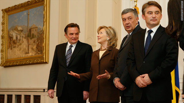 U.S. Secretary of State Hillary Clinton talks with members of the Bosnian tripartite presidency in Sarajevo on October 12, 2010.