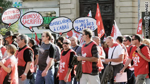 Protesters march in Marseille on Tuesday.