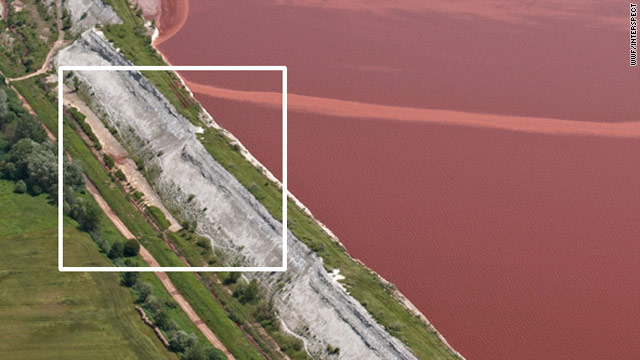 "A photo the WWF says was taken of the Hungarian spill site in June, showing ""a damaged and clearly leaking sludge pond wall."""