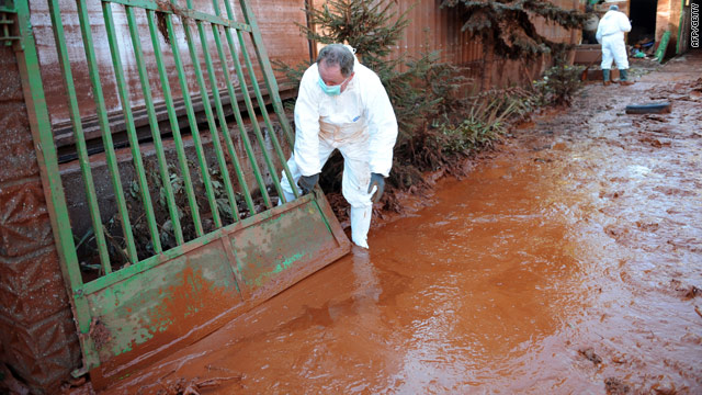 Workers clear up the toxic sludge in Devecser, 150 km west of Budapest on Monday.