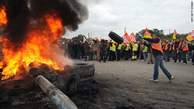 Striking workers burn tires at an oil refinery in Saint-Nazaire, France, on Friday.