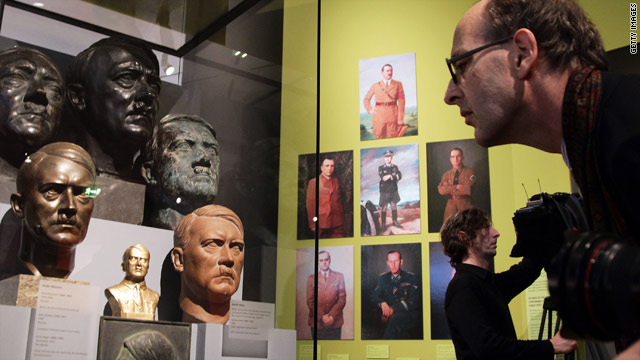 A visitor looks at busts of Adolf Hitler in the &quot;Hitler and the Germans&quot; exhibit at the German Historical Museum.