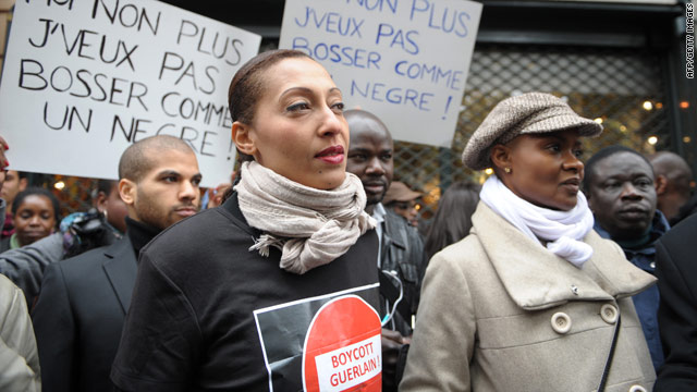 Protesters gather Saturday outside the Guerlain boutique in Paris, France, after a former exec made racial remarks.