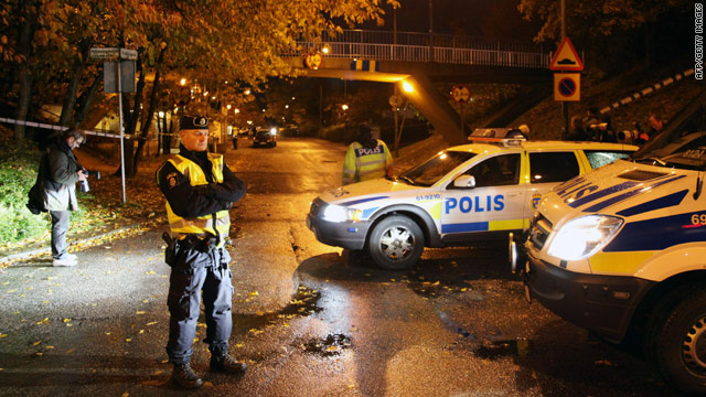 Police secure the area where two immigrant women were shot Thursday in Malmo, Sweden.