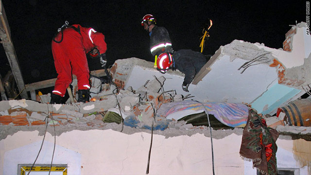 Rescue workers examine the collapsed roof of a building in Kraljevo, in central Serbia, on November 3, 2010.