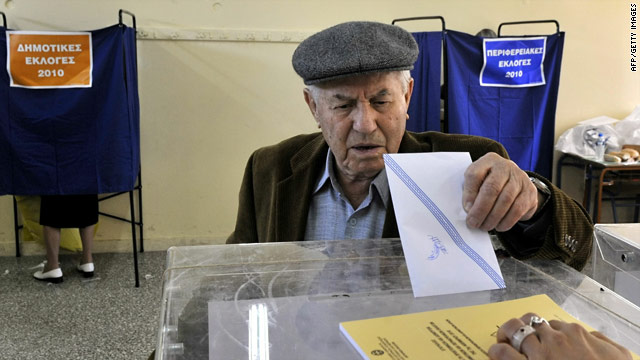 A man casts his ballot for the local and regional elections in a voting center in Athens on November 7, 2010.
