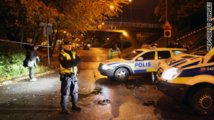 Swedish police secure the area where two people were shot in Malmo, Sweden, on October 21.