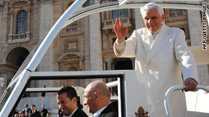 Pope Benedict XVI waves as he leaves on Wednesday after his weekly general audience in St. Peter's Square.