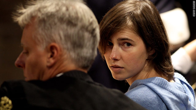 Amanda Knox speaks to her legal team on Wednesday during her appeal against her murder conviction.