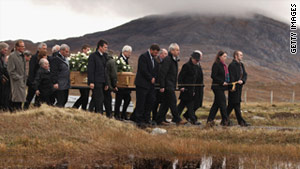 Family and friends carry the coffin of Linda Norgove in Uig on the Isle of Lewis on October 26.