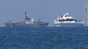 An Israeli military vessel, left, escorts a ship from an aid convoy trying to reach Gaza on May 31.