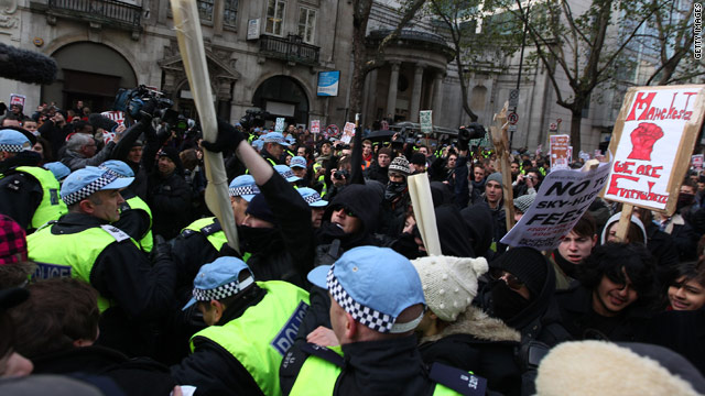 Police officers clash with student demonstrators marching towards Parliament on December 9, 2010 in London.