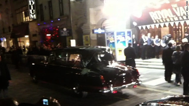 The royal car sits outside the London Palladium following the attack.