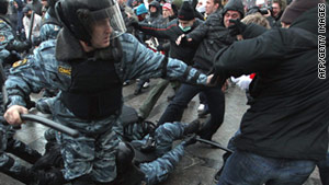 Soccer fans clash with riot police in central Moscow.
