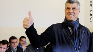 Prime Minister Hashim Thaci gives the thumbs up at a polling center on Sunday.
