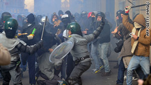 Police clash with angry protestors in Rome in the wake of lawmakers' confidence votes, narrowly in favor of Italian Prime Minister Silvio Berlusconi.
