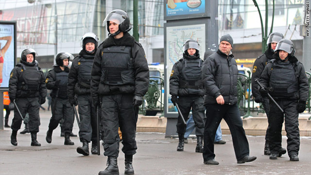Riot police patrol the streets of Moscow in anticipation of clashes between ethnic groups in the capital.