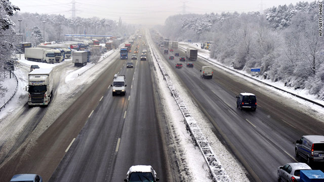 Cars and trucks drive on the motorway A3 near Hilden, Germany, on December 17.