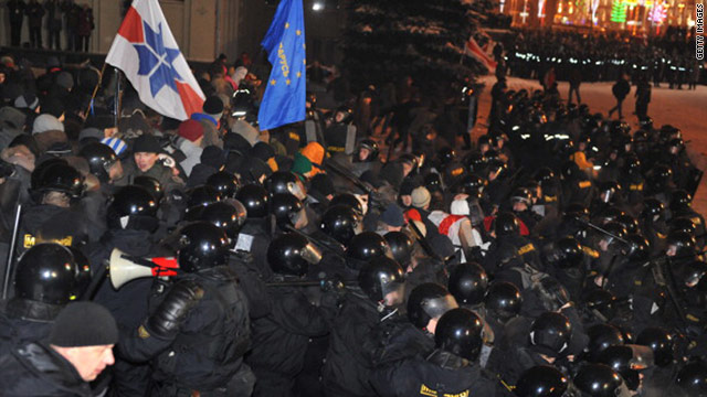 Protesters clash with riot police during an opposition rally in Minsk on Monday.