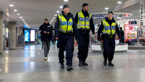 Police patrol at a Stockholm subway station on December 14. Sweden has been on edge since its first suicide bombing.