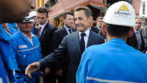 French President Nicolas Sarkozy visits workers at a STX shipyard in Saint-Nazaire, France, in July.