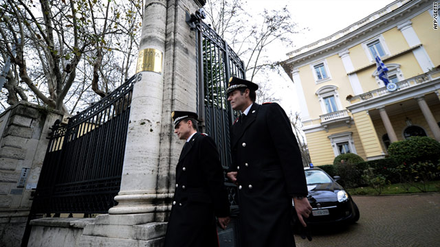 Italian Carabinierei outside the Greek embassy in Rome on December 27, 2010 after an explosive package was found there.