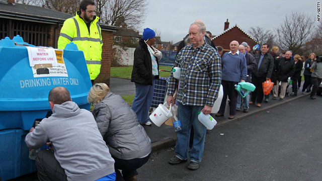 People in Belfast queue for fresh water on December 29, 2010. An estimated 40,000 have been left without running water.