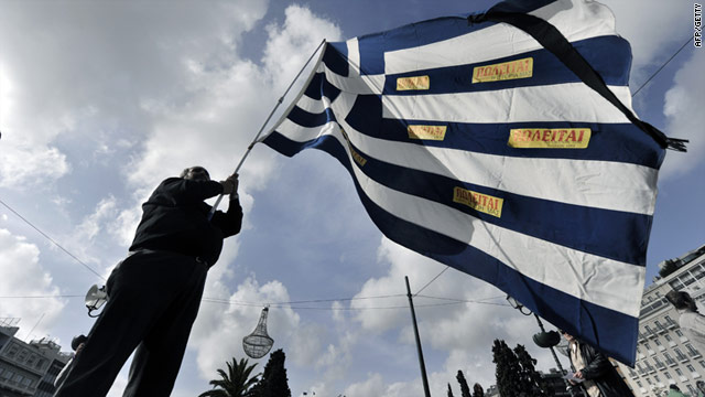 A protester waves a Greek flag in front of the parliament building in Athens in December against austerity measures.
