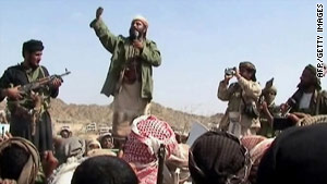 A man claiming to be a member of al Qaeda addresses a crowd in Yemen's southern province in December.