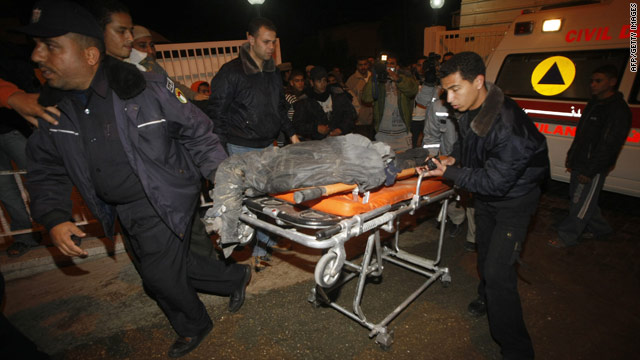 Palestinians wheel a body to a  hospital morgue after Israeli airstrikes hit smuggling tunnels in the Gaza Strip, January 8, 2010.