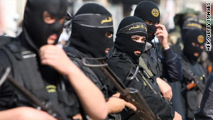 Islamic Jihad militants Monday attend the funeral of a comrade killed in Gaza on Sunday. Two others also died Sunday.