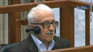 In this image taken from al-Iraqiya Television station on April 29, 2008, Tareq Aziz sits in the dock in a location in Iraq.