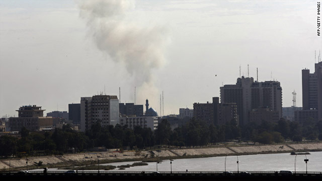 Smoke billows from the site of a car bomb attack on a government forensics office in Baghdad on Tuesday.
