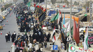 Shiite pilgrims make their way to Karbala in Iraq.