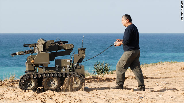 Explosives wash up on israeli beaches cnn an israeli police explosives expert uses a military robot to scan the coast monday after a publicscrutiny Image collections