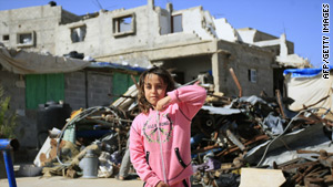 A girl plays near buildings said to have been destroyed in Israel's offensive against Gaza.