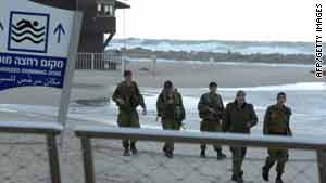 Israeli soldiers patrol a beach in the northern city of Netanya on February 3, 2010.