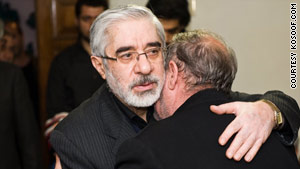 Mir Hossein Moussavi shown greeting grieving relatives of a man killed during protests in Iran.