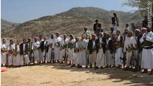 Tribal militants listen to the commander of the Yemeni army during a visit in the Saada province Saturday.