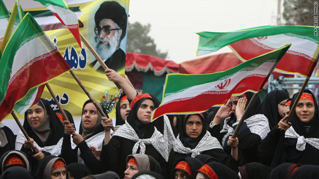 Schoolgirls mark the anniversary of the Islamic revolution at the Behesht-e Zahra (Zahra's Paradise) cemetery in Tehran.