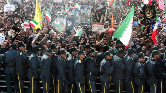Iranian security forces guard the tens of thousands of Iranians who listened to President Ahmadinejad speak.