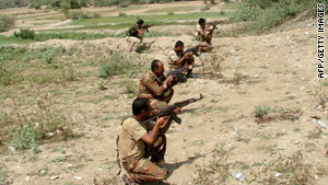 Yemeni troops take positions against rebels in the north Wednesday despite the announcement of a cease-fire.
