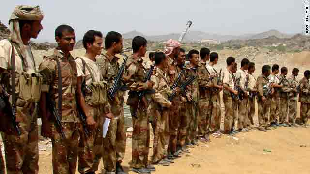 Yemeni troops gather to meet Defence Minister Mohammad Nasir Ahmad during his visit to the frontline in Saada on Friday.